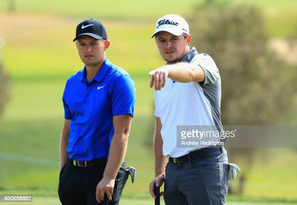 Tom Lewis and Eddie Pepperell of England on the 2nd green during day one of the 2017 Portugal Masters at Oceanico Victoria Golf Club on September 21...