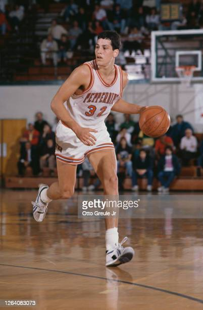Tom Lewis, Forward for the Pepperdine University Waves dribbles the ball down court during the 1988/89 NCAA Pac-10 Conference college basketball...