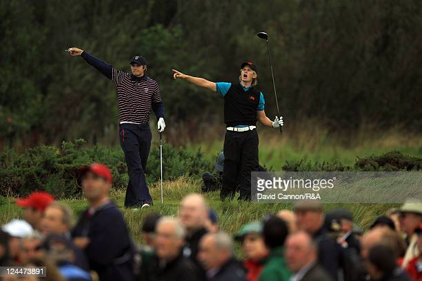 Tom Lewis of England and Great Britain and Ireland screams'fore' as he hits his tee shot at the 15th hole right one of his opponents Peter Uihlein of...