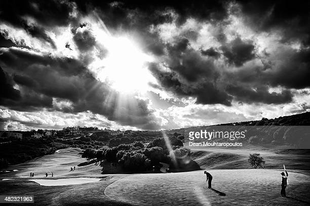Tom Lewis of England hits putts on the 9th green as the sun breaks through the clouds during day one of the NH Collection Open held at La Reserva de...