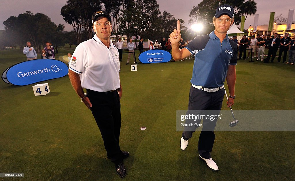 Tom Lewis of England reacts to his putt while Thomas Levet of France is left feeling defeated during the Genworth pro putt challenge after the first round of the UBS Hong Kong open at The Hong Kong Golf Club on November 15, 2012 in Hong Kong.