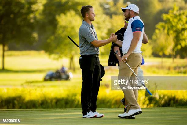 Tom Lewis of England shake hands with Zander Lombard of South Africa during day two of the Saltire Energy Paul Lawrie Matchplay at Golf Resort Bad...