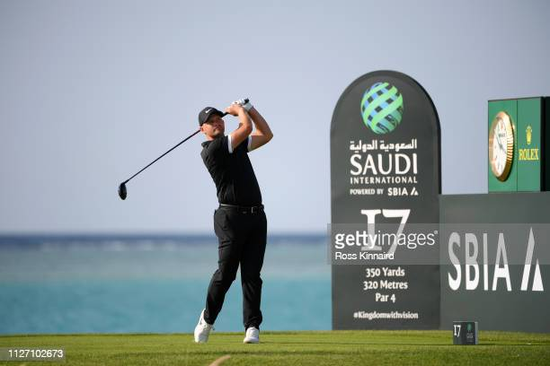 Tom Lewis of England tees off on the 17th hole during Day four of the Saudi International at the Royal Greens Golf Country Club on February 03 2019...