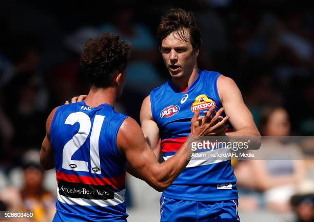 Tom Liberatore and Liam Picken of the Bulldogs celebrate during the AFL 2018 JLT Community Series match between the Western Bulldogs and the Hawthorn...