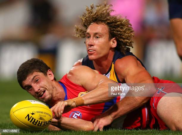 Tom Liberatore of the Bulldogs and Matt Priddis of the Eagles contest for the ball during the round one AFL match between the West Coast Eagles and...