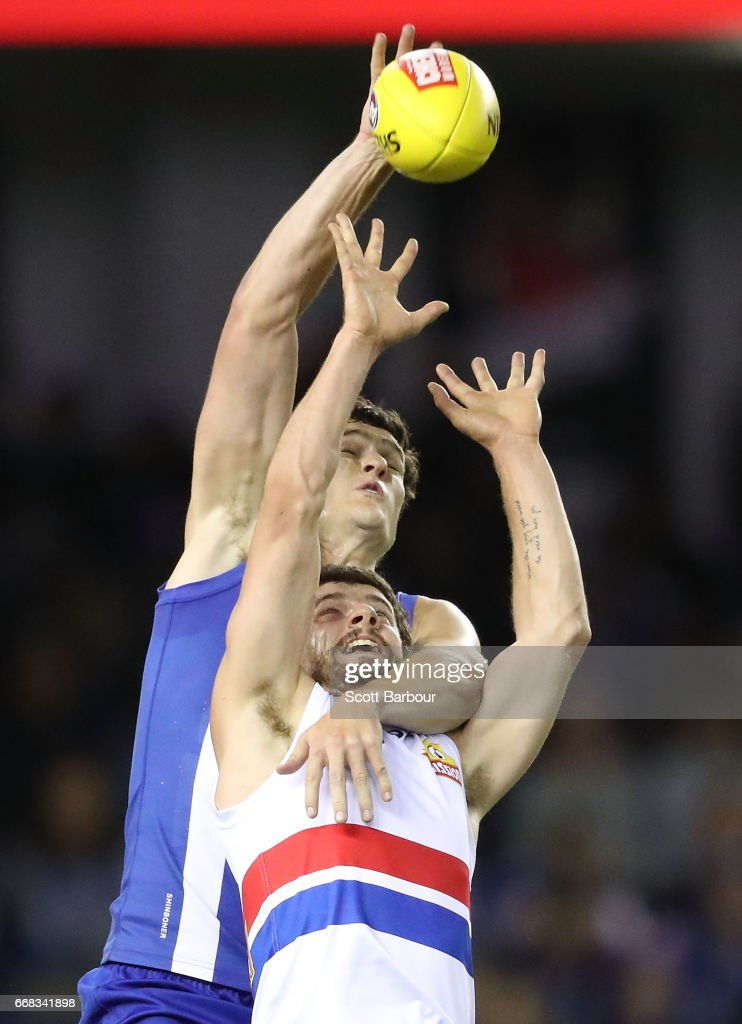 Tom Liberatore of the Bulldogs and Scott Thompson of the Kangaroos compete for the ball during the round four AFL match between the North Melbourne Kangaroos and the Western Bulldogs at Etihad Stadium on April 14, 2017 in Melbourne, Australia.