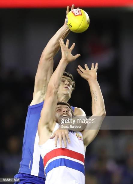 Tom Liberatore of the Bulldogs and Scott Thompson of the Kangaroos compete for the ball during the round four AFL match between the North Melbourne...