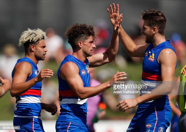 Tom Liberatore of the Bulldogs celebrates a goal with Marcus Bontempelli of the Bulldogs during the AFL 2018 JLT Community Series match between the...