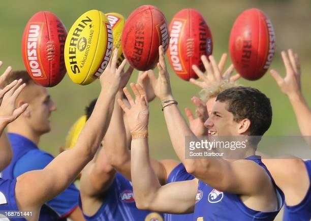 Tom Liberatore of the Bulldogs passes the ball during a Western Bulldogs AFL training session at Whitten Oval on May 15 2013 in Melbourne Australia