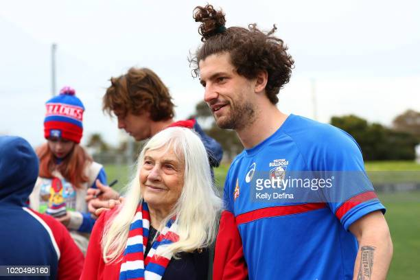 Tom Liberatore of the Bulldogs poses for a photo with a supporter during a Western Bulldogs AFL training session at Whitten Oval on August 21 2018 in...