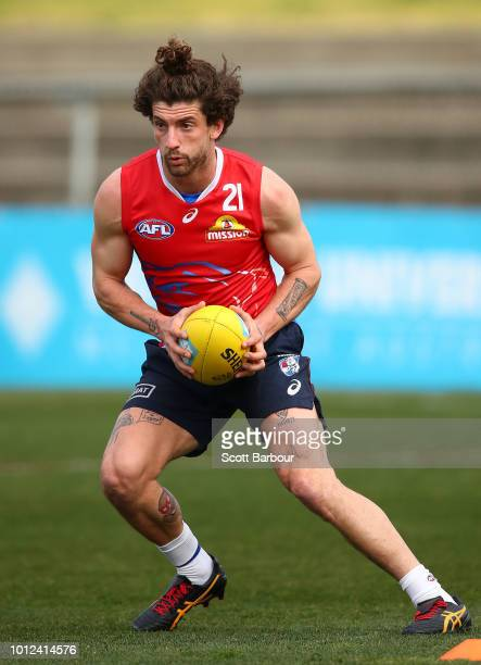 Tom Liberatore of the Bulldogs runs with the ball during a Western Bulldogs AFL training session at Whitten Oval on August 7 2018 in Melbourne...