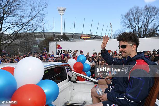 Tom Liberatore of the Bulldogs waves at fans during the 2016 AFL Grand Final Parade on September 30 2016 in Melbourne Australia
