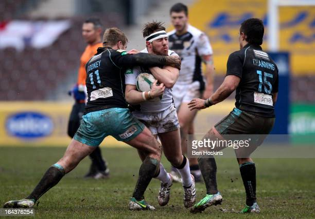 Tom Lineham of Hull is tackled by Shane Rodney of the London Broncos during the Super League match between London Broncos and Hull at Twickenham...