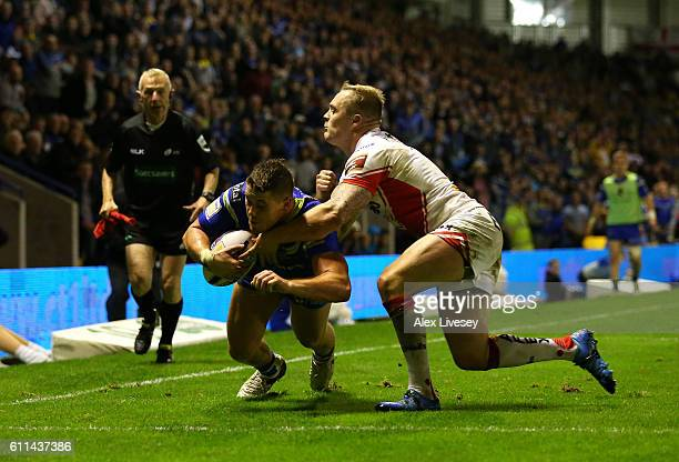 Tom Lineham of Warrington Wolves dives over the line to score a try during the First Utility Super League Semi Final match between Warrington Wolves...