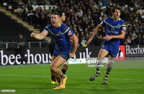 Tom Lineman of Warrington celebrates scoring the match winning try during the First Utility Super League match between Hull FC and Warrington Wolves...