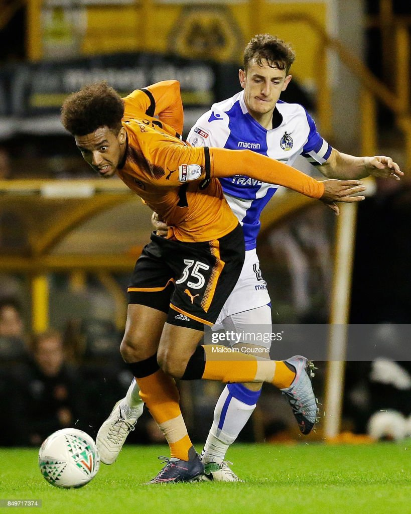 Tom Lockyer of Bristol Rovers pulls back Donovan Wilson of Wolverhampton Wanderers and is sent off during the Carabao Cup tie between Wolverhampton Wanderers and Bristol Rovers at Molineux on September 19, 2017 in Wolverhampton, England.