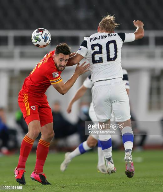 Tom Lockyer of Wales and Joel Pohjanpalo of Finland battle for the ball during the UEFA Nations League group stage match between Finland and Wales at...