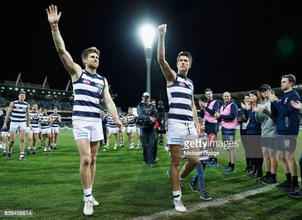 Tom Lonergan of the Cats and Andrew Mackie wave to fans after their win during the round 23 AFL match between the Geelong Cats and the Greater...