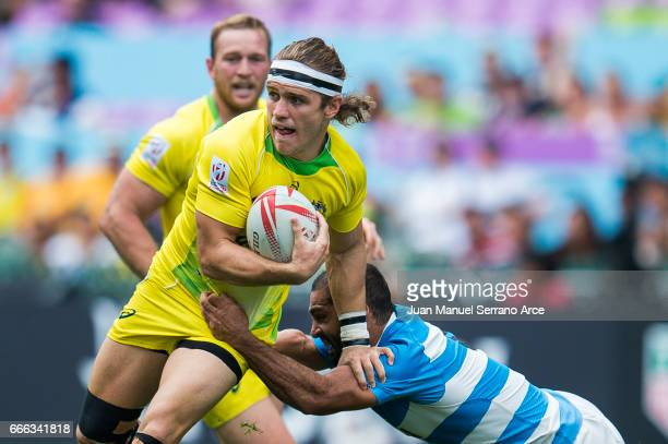 Tom Lucas of Australia is tackled during the 2017 Hong Kong Sevens match between Australia and Argentina at Hong Kong Stadium on April 9 2017 in Hong...
