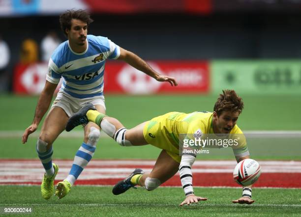 Tom Lucas of Australia jumps for the ball near Eugenio Plottier of Uruguay during the Canada Sevens the Sixth round of the HSBC Sevens World Series...