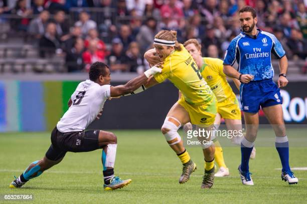 Tom Lucas of Australia pushed Jerry Tuwai of Fiji away during day 2 of the 2017 Canada Sevens Rugby Tournament on March 12 2017 in Vancouver British...