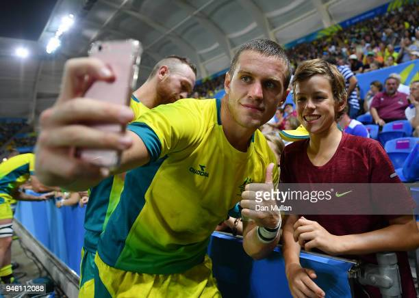 Tom Lucas of Australia takes a picture with a fan following the Rugby Sevens Men's Pool B match between England and Australia on day 10 of the Gold...