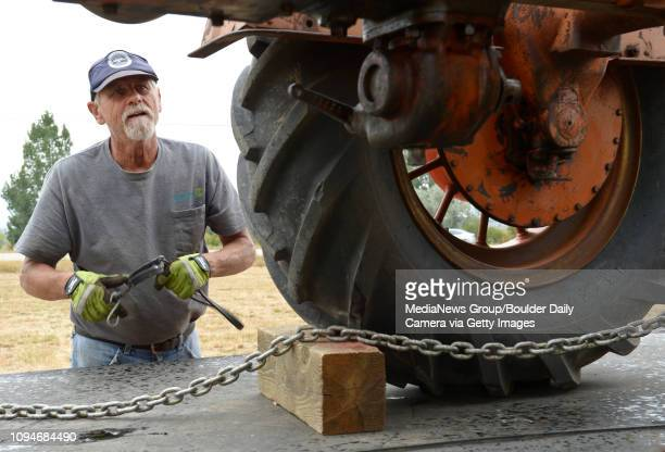Tom Lukow gets ready to unload a 1936 AllisChalmers tractor Wednesday for this weekend's Yesteryear Farm Show at the Dougherty Museum 8306 N 107th St...
