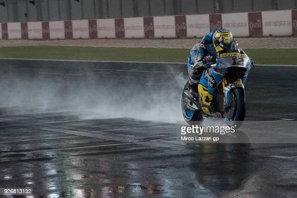 Tom Luthi of Switzerland and and Team EG 0,0 Marc VDS heads down a straight and test the wet track during the Moto GP Testing - Qatar at Losail...