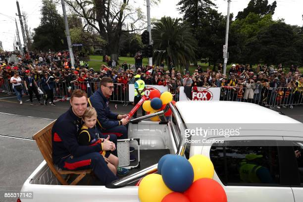 Tom Lynch and Josh Jenkins of the Crows are driven through the city during the 2017 AFL Grand Final Parade ahead of the Grand Final between the...