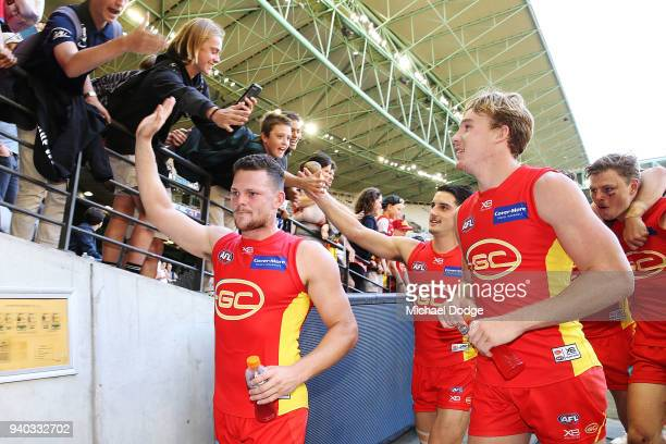 Tom Lynch and Steven May of the Suns celebrate after winning during the round two AFL match between the Carlton Blues and the Gold Coast Suns at...