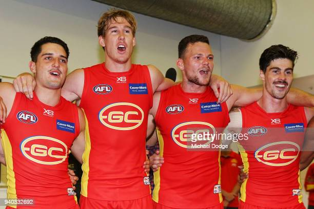 Tom Lynch and Steven May of the Suns sing the club song after winning during the round two AFL match between the Carlton Blues and the Gold Coast...