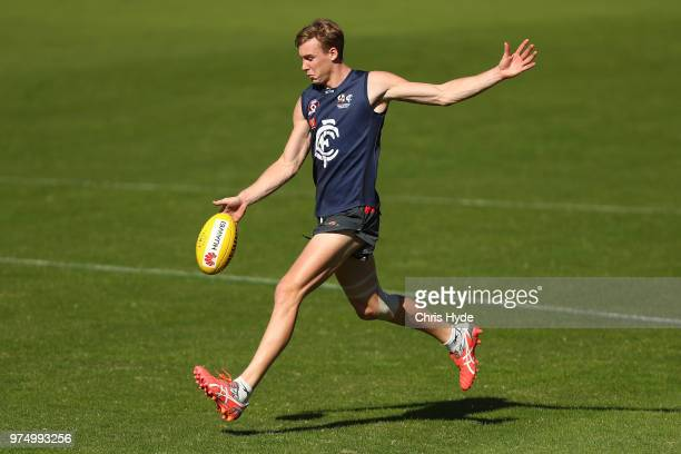 Tom Lynch kicks during a Gold Coast Suns AFL training session at Metricon Stadium on June 15 2018 in Gold Coast Australia