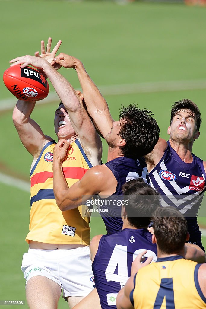 Tom Lynch of the Crows and Alex Silvagni of the Dockers contest for the ball during the 2016 AFL NAB Challenge match between the Fremantle Dockers and the Adelaide Crows at Sounness Park on February 28, 2016 in Perth, Australia.