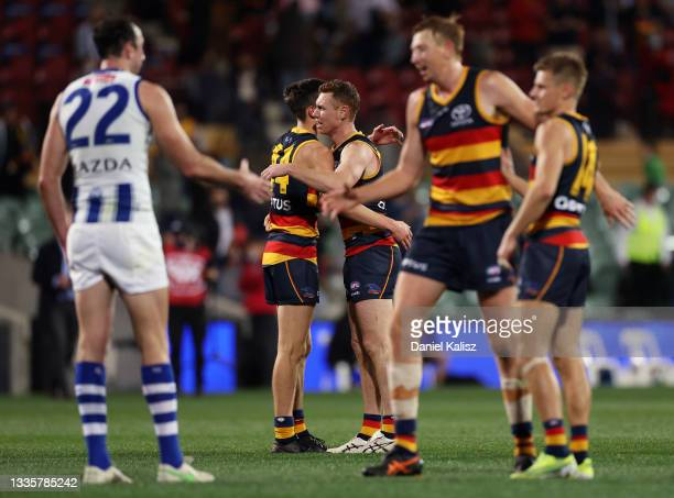 Tom Lynch of the Crows and Lachlan Gollant of the Crows celebrate after the siren during the round 23 AFL match between Adelaide Crows and North...