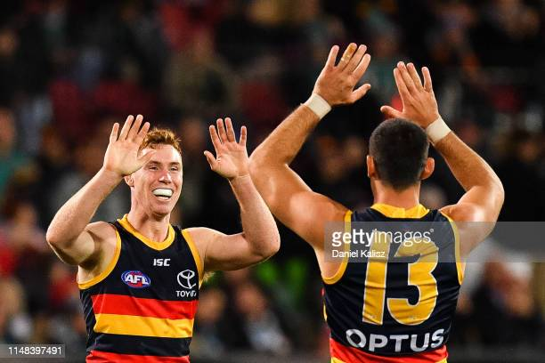 Tom Lynch of the Crows and Taylor Walker of the Crows celebrate during the round eight AFL match between the Port Adelaide Power and the Adelaide...
