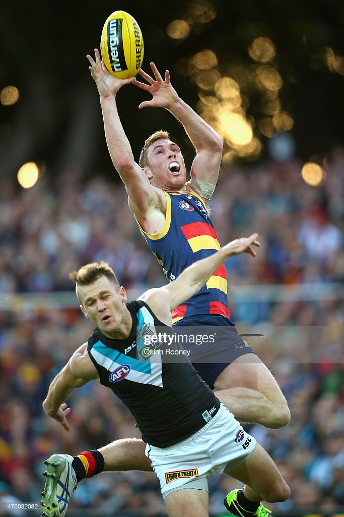 Tom Lynch of the Crows flies for a mark over the top of Robbie Gray of the Power during the round five AFL match between the Adelaide Crows and the Port Adelaide Power at Adelaide Oval on May 3, 2015 in Adelaide, Australia.