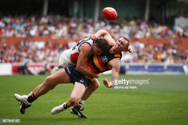 Tom Lynch of the Crows is tackled by Heath Shaw of the Giants during the round one AFL match between the Adelaide Crows and the GWS Giants at...