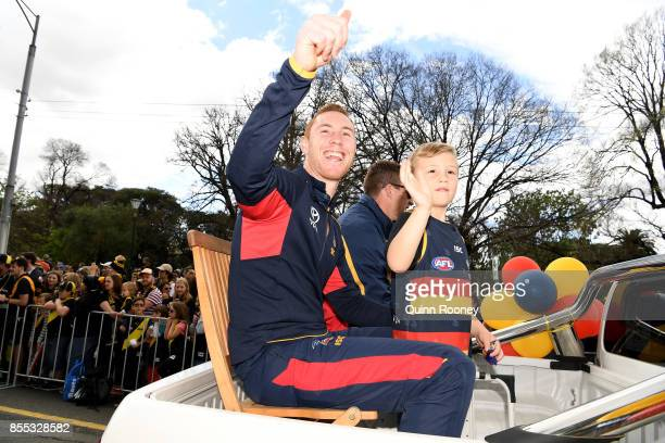 Tom Lynch of the Crows waves to fans during the 2017 AFL Grand Final Parade ahead of the Grand Final between the Adelaide Crows and the Richmond...