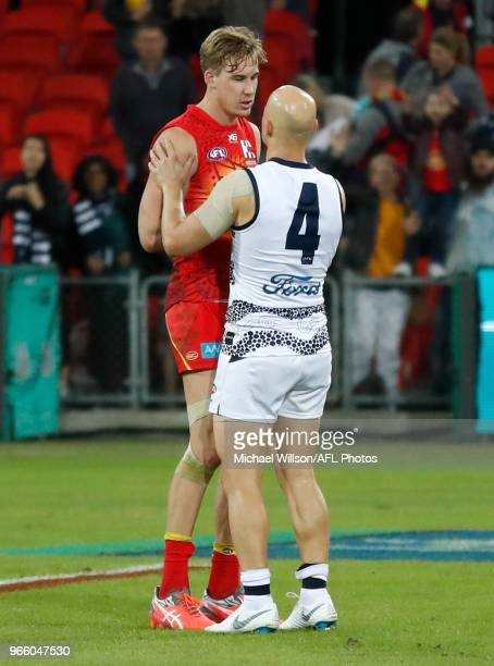 Tom Lynch of the Suns and Gary Ablett of the Cats shake hands after the 2018 AFL round 11 match between the Gold Coast Suns and the Geelong Cats at...