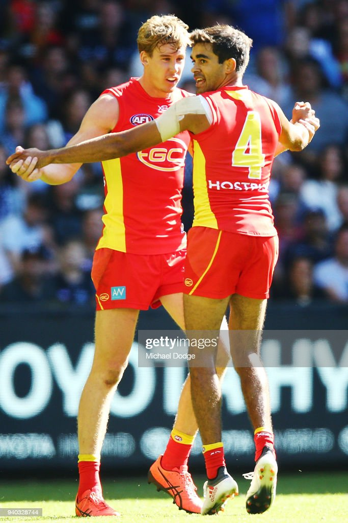 Tom Lynch of the Suns (L) and Jack Martin celebrate a goal during the round two AFL match between the Carlton Blues and the Gold Coast Suns at Etihad Stadium on March 31, 2018 in Melbourne, Australia.