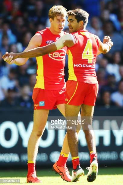 Tom Lynch of the Suns and Jack Martin celebrate a goal during the round two AFL match between the Carlton Blues and the Gold Coast Suns at Etihad...