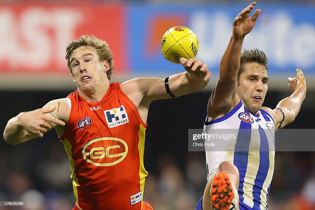 Tom Lynch of the Suns and Jamie Macmillan of the Kangaroos compete for the ball during the round 14 AFL match between the Gold Coast Suns and the North Melbourne Kangaroos at Metricon Stadium on July 4, 2015 in Gold Coast, Australia.