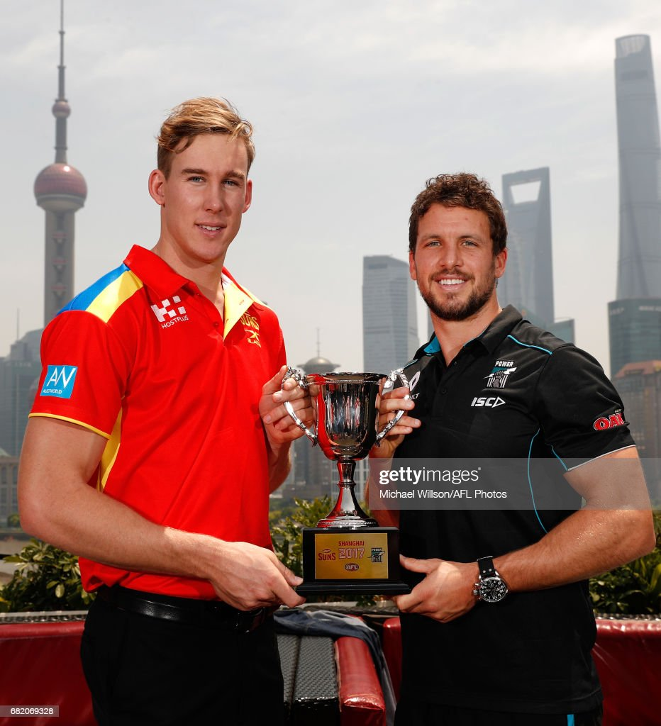 Tom Lynch of the Suns (left) and Travis Boak of the Power pose for a photograph with the 2017 Shanghai Cup during the Port Adelaide Power and Gold Coast Suns joint Captain and Coach press conference at Bar Rouge overlooking The Bund on May 11, 2017 in Shanghai, China.