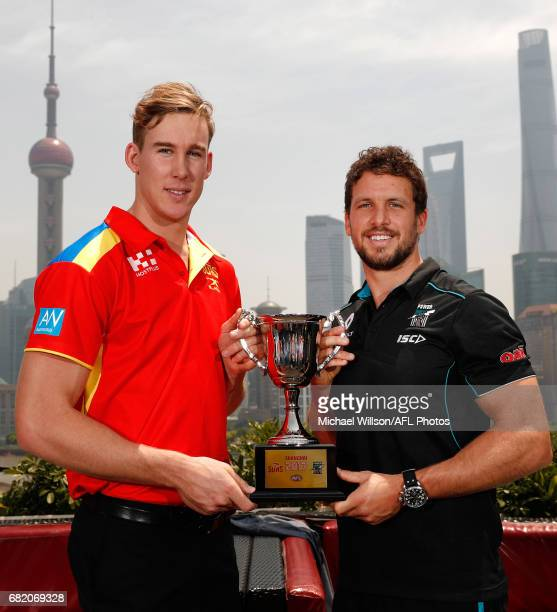 Tom Lynch of the Suns and Travis Boak of the Power pose for a photograph with the 2017 Shanghai Cup during the Port Adelaide Power and Gold Coast...