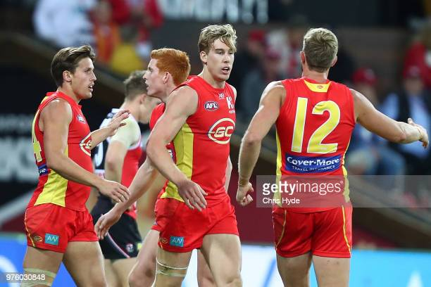 Tom Lynch of the Suns celebrates a goal during the round 13 AFL match between the Gold Coast Suns and the St Kilda Saints at Metricon Stadium on June...