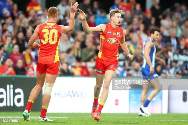 Tom Lynch of the Suns celebrates a goal during the round 15 the Gold Coast Suns and the North Melbourne Kangaroos at Metricon Stadium on July 1 2017...