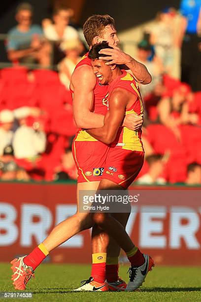 Tom Lynch of the Suns celebrates a goal during the round 18 AFL match between the Gold Coast Suns and the Fremantle Dockers at Metricon Stadium on...
