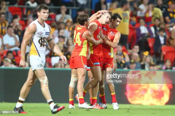 Tom Lynch of the Suns celebrates a goal during the round three AFL match between the Gold Coast Suns and the Hawthorn Hawks at Metricon Stadium on...