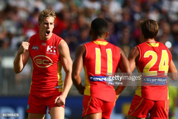 Tom Lynch of the Suns celebrates a goal during the round three AFL match between the Gold Coast Suns and the Fremantle Dockers at Optus Stadium on...