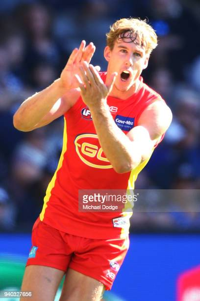 Tom Lynch of the Suns celebrates a goal during the round two AFL match between the Carlton Blues and the Gold Coast Suns at Etihad Stadium on March...